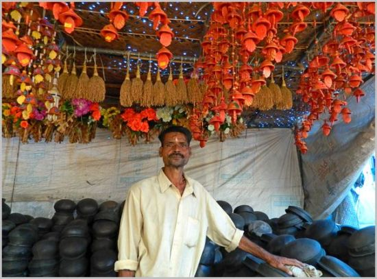 Clay cooking pots and decorative terracotta. A craftsman and his wares at a weekly market in Kerala.